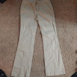 Tan jeans with boot cut bottom